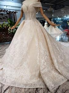 Image 3 - BGW HT43028 Sexy hors de lépaule robe de mariée avec longue Train dentelle Appliques perlée chérie luxe robe de mariée nouvelle arrivée