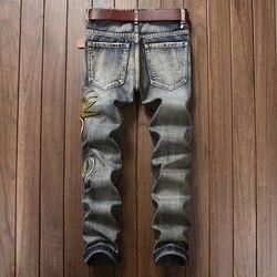 Pantalones vaqueros rasgados con agujeros de diseñador Harajuku para hombre, pantalones de mezclilla Vintage bordados con flores, pantalones lavados Casuales