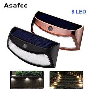 Image 1 - Solar Power Light 8 LED Outdoor Solar Smiling Wall Lights Copper Black Wireless Light Night Lamps for Stair Garden Doorway