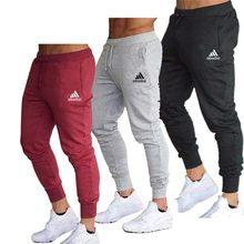Nuova primavera autunno marca palestre uomo pantaloni sportivi pantaloni sportivi pantaloni sportivi abbigliamento sportivo pantaloni Bodybuilding di alta qualità
