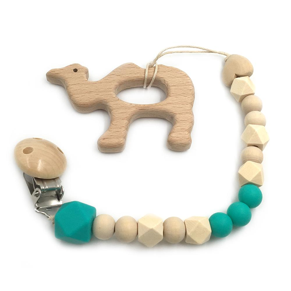 green wooden camel toy