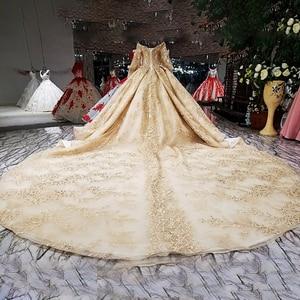 Image 2 - LS68774 יוקרה כדור שמלת שמלת ערב 2020 ארוך שרוול כבוי כתף פרחי זהב מבריק 100% אמיתי כמו תמונות