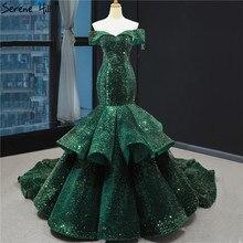 최신 디자인 녹색 인어 섹시 웨딩 드레스 어깨 떨어져 반짝이 신부 가운 2020 실제 그림 HM66886