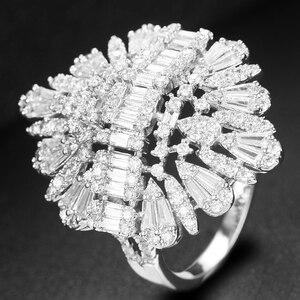 Image 4 - Godki 2020 nova moda luxo charme aaa baguette corte zircão cúbico anéis de casamento para mulheres t forma pedra festa de casamento jóias