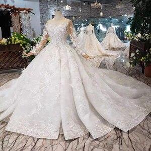 Image 4 - Bgw HT4304 特別ウェディングドレスと羽のためのシースルーバック手作りボタンブライダルドレス vestido デ noiva プリンセサ