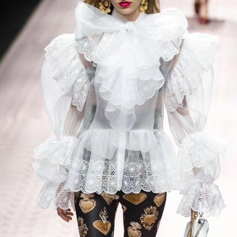 Haute rue Sexy femmes hauts et chemisiers manches bouffantes tunique Royal nœuds Sexy voir à travers chemisier chemise vêtements femmes blanches A008