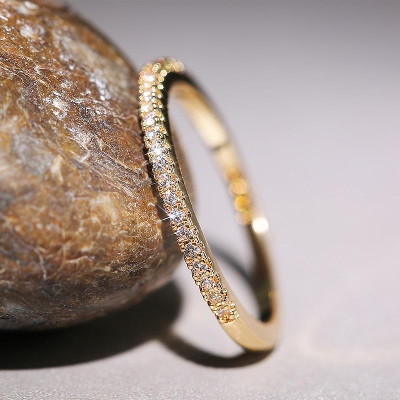 Huitan-Anillos finos minimalistas para mujer, de circón cúbico brillante para boda, sortija versátil para dedo, joyería 2020