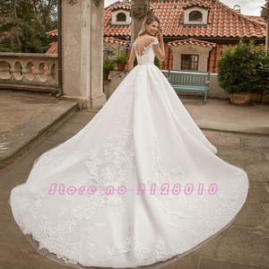 Image 2 - 2020 New Special Princess Ball Gown Wedding Dresses Plus Size Mariage Sparkly Beading Crystal Waist Appliques Short Sleeve Dress