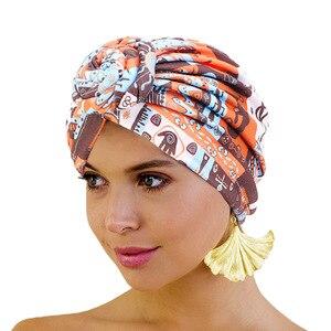 Image 1 - Nowe kobiety afrykański wzór wiązane Turban w kwiaty Turban muzułmański Twist Knot indie kapelusz panie czepek dla osób po chemioterapii bandany akcesoria do włosów