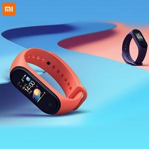 Image 2 - 85% 새로운 Xiaomi Mi Band 4 스마트 팔찌 3 색 AMOLED 스크린 심박수 피트니스 블루투스 5.0 스포츠 50ATM 방수 SmartBand