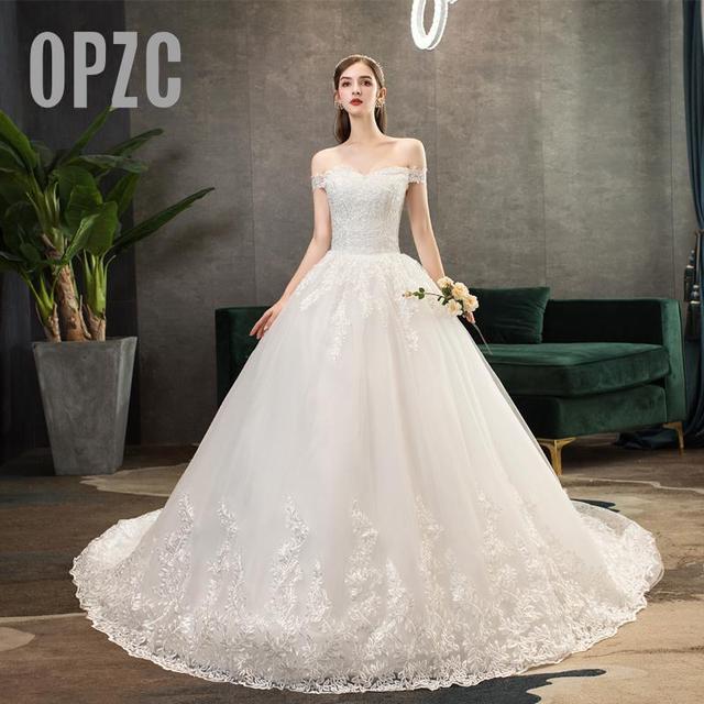 Neue Ankunft Süße Elegante Prinzessin Luxus Spitze Hochzeit Kleid 100 cm Boot ausschnitt Appliques Promi Ballkleid vestido De Noiva
