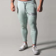 Męskie spodnie dresowe Fitness kulturystyka męskie spodnie na co dziń z nadrukiem mężczyźni spodnie joggery bawełniane spodnie dresowe Slim w stylu Fit Streetwear męski spodni tanie tanio GYKZ Ołówek spodnie Mieszkanie COTTON Kieszenie REGULAR 2 23 - 2 62 Pełnej długości ZTKC-CK-09 Na co dzień Midweight