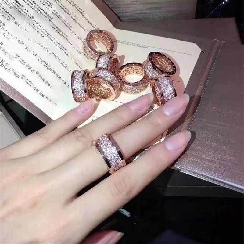 Nuevo Producto más vendido nunca se desvanece joyería clásica de acero de titanio circonita blanca completa mujeres anillo de boda de resorte regalo con Logo