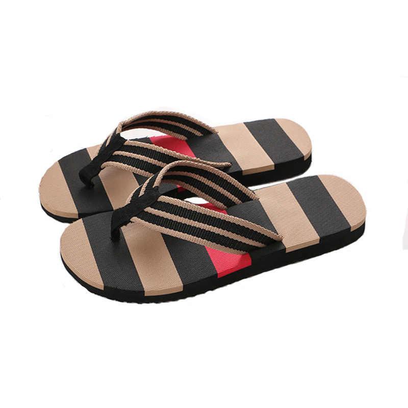 ฤดูร้อนใหม่ผู้ชายรองเท้าแตะชายลื่นรองเท้าแตะและรองเท้าแตะระเบิดแฟชั่นรองเท้าชายหาดขายส่ง