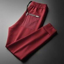 Minglu الأحمر رجالي السراويل الفاخرة سستة جيوب بلون رياضي غير رسمي سروال رجالي الخريف والشتاء سليم صالح رجل بنطلون 4XL