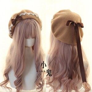 Image 3 - יפני Kawaii כומתה כובע לוליטה בגיל ההתבגרות לב מתוק צמר בעבודת יד חמוד תחרה Bowknot חם סתיו חורף צייר כובע כיסוי ראש
