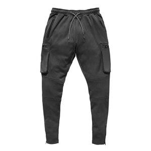 Image 2 - Męskie trening Fitness spodnie do biegania multi zip pocket Cargo Workout spodnie sportowe bawełniane męskie Gym Jogging taktyczne spodnie bojowe