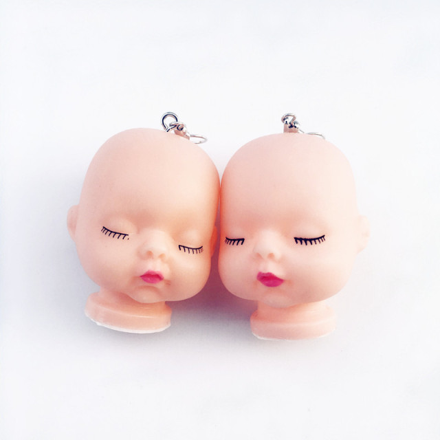 Sleeping Baby Head Earrings 1
