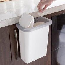 Кухонный шкаф двери висит мусорное ведро мусорные ящики для