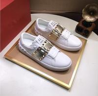 Zapatillas de deporte de marca de cuero genuino para hombre y mujer, zapatos deportivos informales con remaches para correr, tenis para caminar y monopatín, Unisex