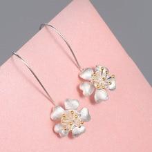 купить New S925 Silver Earrings For Women Fashion Elegant Silver Small Cute Flower Pendant Large Hook Jewelry Drop Earrings Female по цене 184.32 рублей