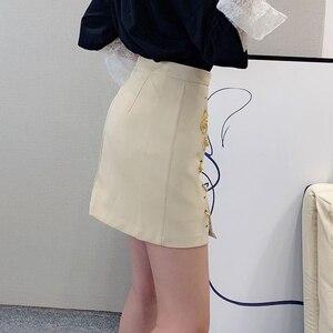 Image 4 - Deuxtwinstyle Patchwork broches asymétrique femmes jupes taille haute en cuir PU décontracté Mini jupe pour femme 2020 mode vêtements