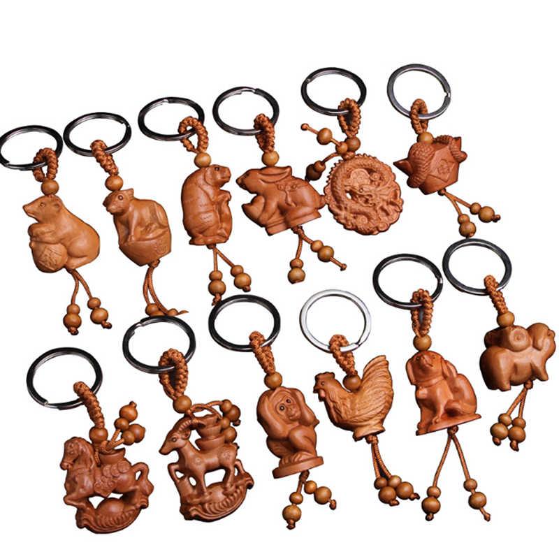 موضة الخشب الطبيعي 12 زودياك المفاتيح للجنسين الأطفال الحيوان قرد الأغنام ثعبان التنين النمر سلسلة مفاتيح حلقة رئيسية