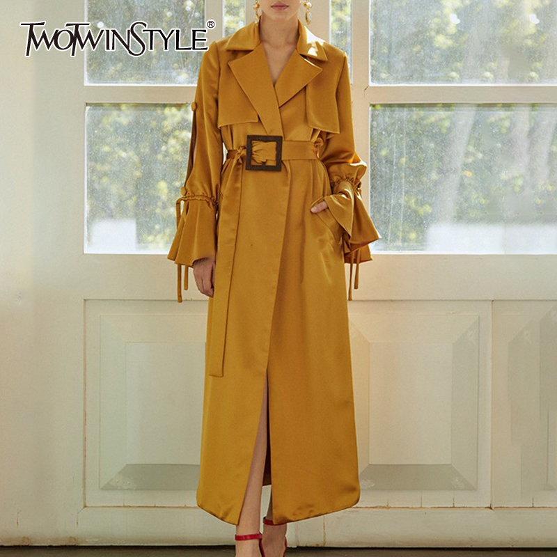 TWOTWINSTYLE Hollow Out Women's Windbreaker Lapel Collar Flare Sleeve High Waist With Sashes Trench Coat Female Autumn New 2020