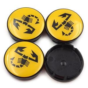 Image 3 - 20 pc/lot 56mm jaune Abarth emblème de voiture roue Center moyeu capuchon jante insigne couvre Scorpion roue central casquettes 5JA601151A