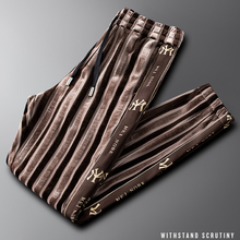 Light luxury striped gold velvet sports casual pants Slim be