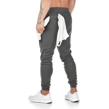 Spodnie dresowe dla joggerów męskie spodnie na co dzień solidne szare czarne siłownie Fitness Workout spodnie sportowe męskie bawełniane spodnie Trackpants ołówek tanie i dobre opinie GLOBESKY 28 - 40 Sznurek Pełnej długości NONE Track pants for men Mieszkanie Midweight Poliester COTTON Jodełkę skinny