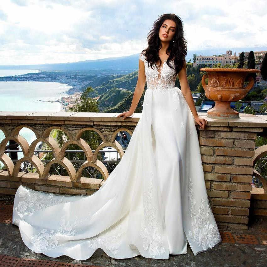 מדהים קו תחרה Overskirt שמלות כלה Sheer Bateau צוואר ללא משענת שמלות כלה לטאטא רכבת Appliqued טול בתוספת גודל