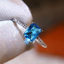 Huitan femelle bleu Rectangle quatre griffes anneaux de mariage Micro pavé bague CZ pour les femmes grâce fiançailles cadeau de luxe à la mode bijoux