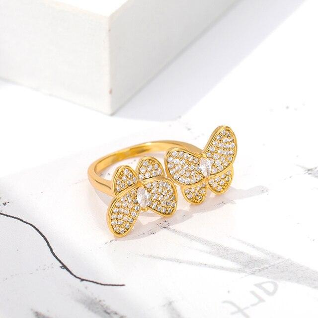 Фото женское кольцо с бабочкой золотистое/серебристое обручальное цена