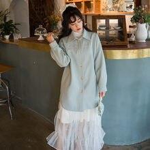 Оригинальное плотное стеганое длинное пальто с вышивкой