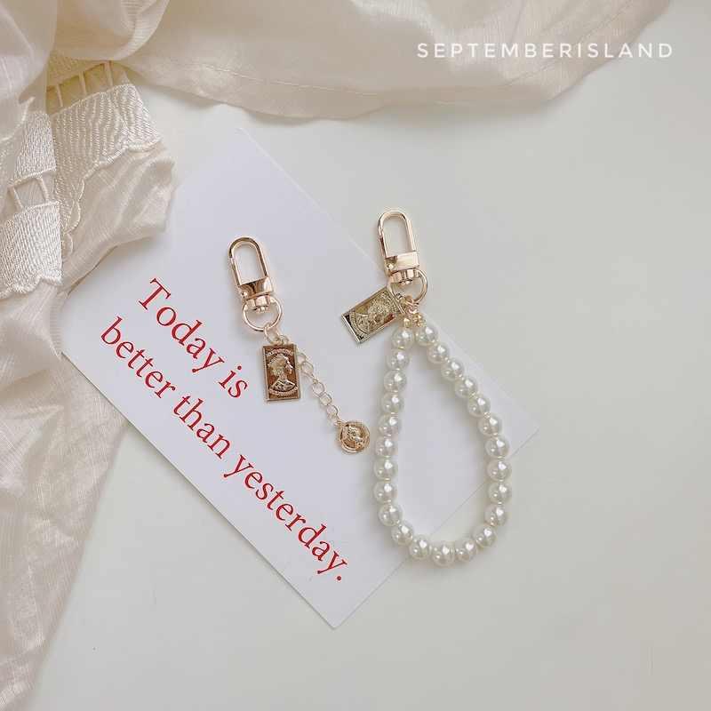 Di trasporto del nuovo creativo fiore di cristallo portachiavi Perla anello chiave dell'automobile Femminile pendente del sacchetto accessori dei monili di Fascino chiave catene di lusso cordino