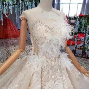 Image 5 - Champagne sans manches robes de mariée Sexy 2020 Dubai luxe paillettes plumes robes de mariée HX0005 sur mesure