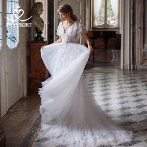 Image 2 - Boho Illusion Wedding Dress V neck Appliques A Line Lace up Court Train Swanskirt D109 Bridal Gown Princess Vestido de novia