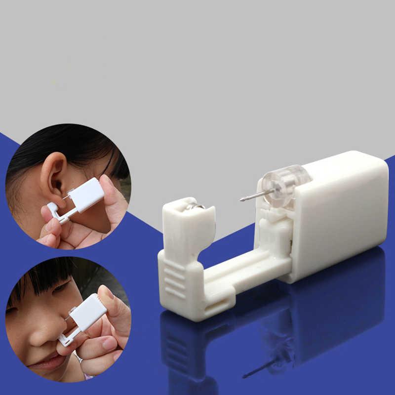 Unidade de Perfuração Estéril descartável Seguro Para O Nariz Studs Piercing Gun Piercer Ferramenta Kit Máquina de Parafuso Prisioneiro Brinco Da Jóia Do Corpo