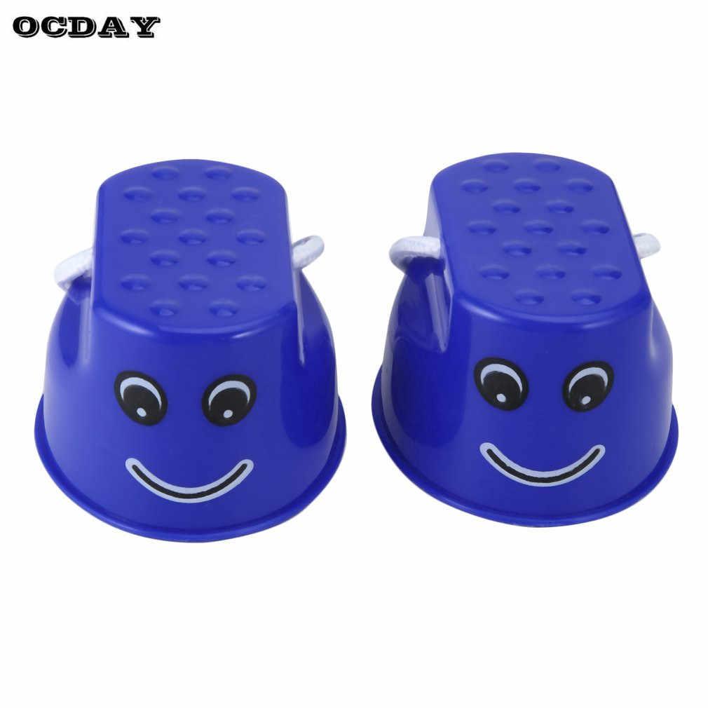 OCDAY 1 set di Plastica Divertente Camminare Trampoli Salto Per Bambini Kids Outdoor Divertimento Sorriso Viso Modello Sport Bilanciamento del Giocattolo di Formazione best regalo