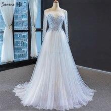 2020 Lighe niebieskie długie rękawy suknie wieczorowe O Neck frezowanie cekinami sukienki wizytowe długie Serene Hill HM66967