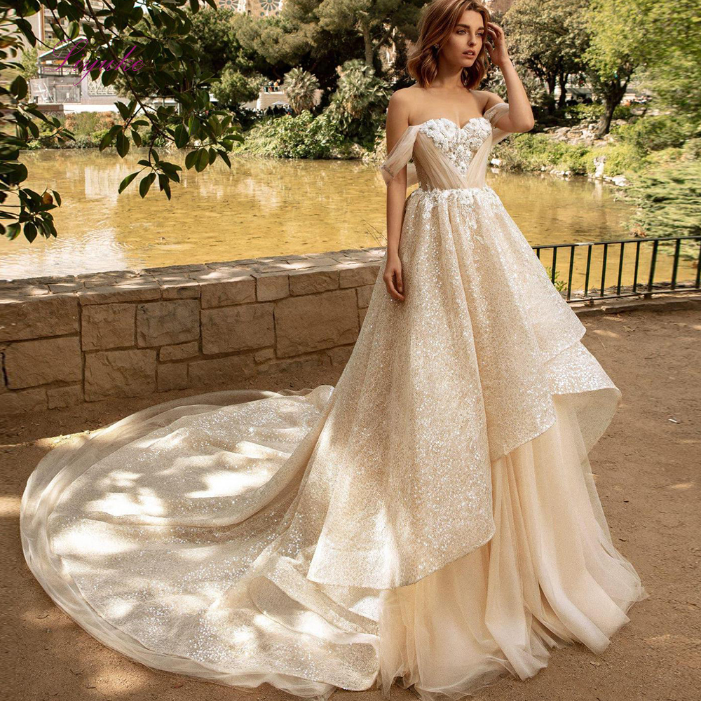 Liyuke A Line Luxury Wedding Dress Sweetheart Lace Appliques Tank Sleeveless Sequined Giltter Tulle Wedding Gown Chapel Train