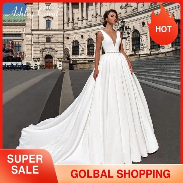Ashley Carol Satin Ball Gown Wedding Dress 2020 Beaded V neck Sleeveless Backless Luxury Princess Bride Gown Vestido de Noiva
