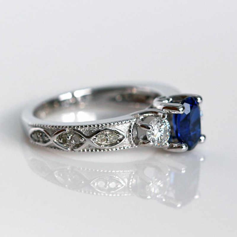 Huitan สีฟ้าหินงานแต่งงานแหวน Luxury Triple คริสตัลหิน PRONG การตั้งค่ารูปแบบหรูหราผู้หญิงเครื่องประดับแหวน