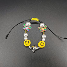 2020 new hip hop rock trend male and female universal smiling face ceramic skull head screen Butterfly Pearl hand woven Bracelet(China)