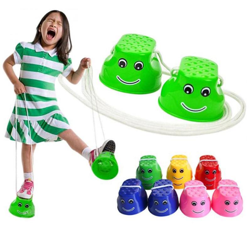 1 paires enfants en plein air en plastique Balance formation sourire visage sautant échasses chaussures Walker jouet amusant Sport jouets cadeau livraison directe