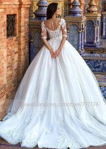 Image 4 - Robe de mariée avec des fleurs 3D, en Tulle, Illusion, à col rond, avec des boutons à larrière, Train Court, robe de mariée