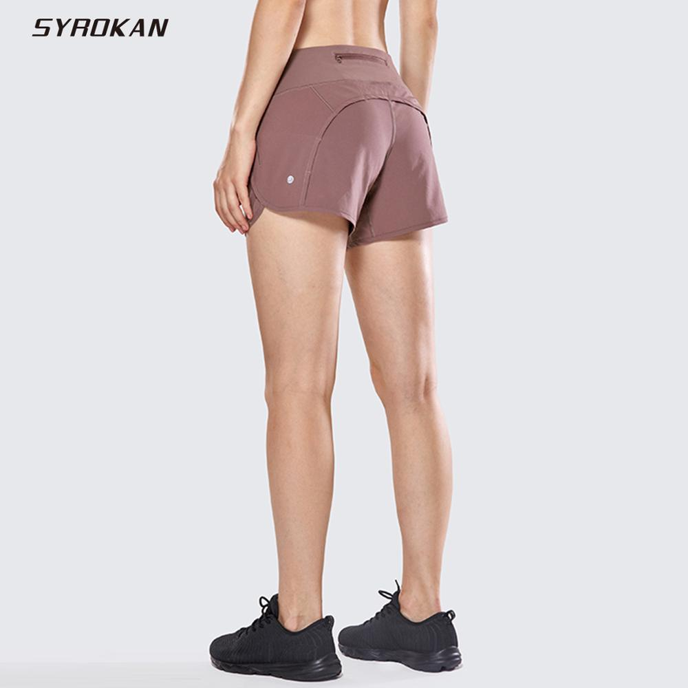 SYROKAN Women's Athletic Workout Sports Running Shorts With Zip Pocket - 4 Inches