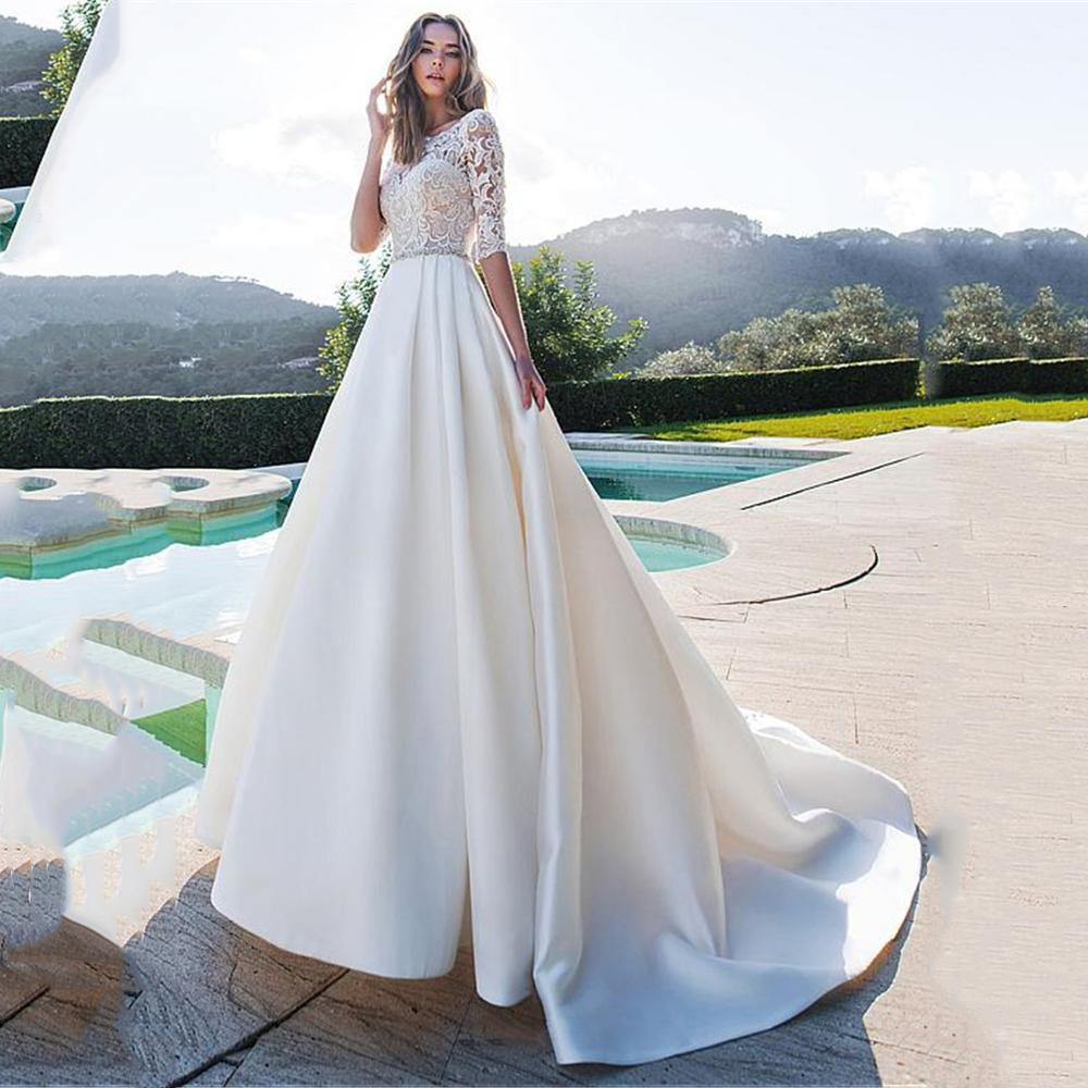 Satin Bateau Neck A-line Wedding Dresses With Lace Half Sleeves Button Back Bridal Gowns With Pockets