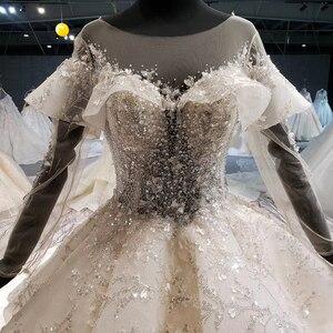 Image 5 - HTL1086 long sleeve wedding dress bohemian bead crystal shiny lace princess bridal dress wedding gown illusion платье свадебное